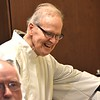 Fr. Johnny flashes a quick smile in the sacristy before Mass