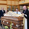 Preparing the casket for the Mass