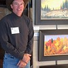 This is Cody with some of his paintings on exhibit.
