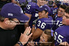Coach Patterson looking like he is going to give the little girl a high five and the little girl appears to be clapping with joy.  It's almost a miracle that such a small child could make it through the crowd.  All of those big football players and there in the middle of it all, a young child, complete with TCU on her cheek and purple bow.  Look at the expressions on the players faces. Nothing wrong with this picture, that is for sure.