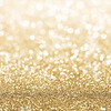 Gold defocused glitter background with copy space