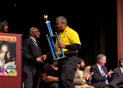 John E. Jones presents athletic excellence awards for teams placing 1st in the state