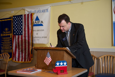 Fayette County GOP Chairman Lane Watts reviews agenda items before the monthly breakfast