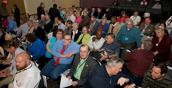 Fayette County delegates discuss upcoming votes during a recess