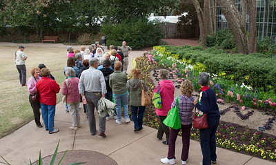 Master Gardeners accompany Brian past the Sibley Center
