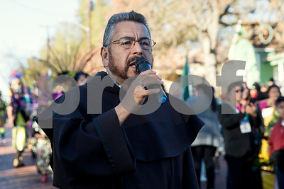 Father Luis Larrea speaks at St. Peter Claver Parish's parade in recognition of the Feast Day of Our Lady of Guadalupe in Tyler, Texas, on Sunday, Dec. 10, 2017. (Chelsea Purgahn/Tyler Morning Telegraph)