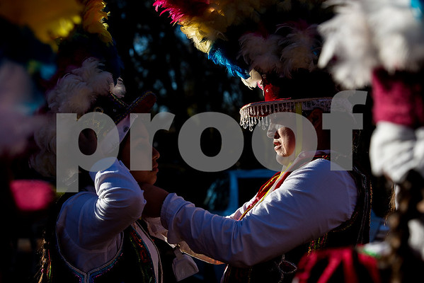 Lucy Zavala, right, helps a friend put on their headpiece at  St. Peter Claver Parish's parade in recognition of the Feast Day of Our Lady of Guadalupe in Tyler, Texas, on Sunday, Dec. 10, 2017. (Chelsea Purgahn/Tyler Morning Telegraph)