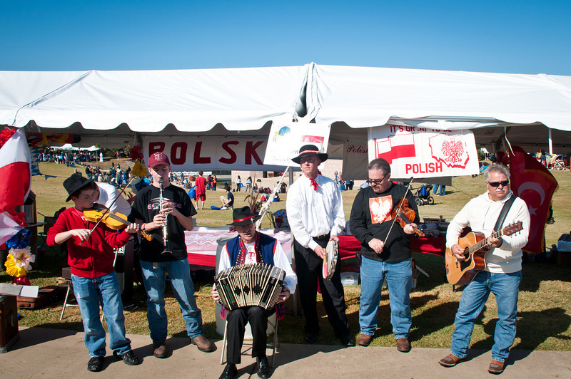 Musicans playing Polish music in front of the Polish Genealogical Society of Texas booth.