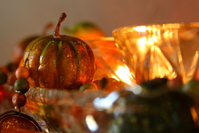 A centerpiece of pumpkins and holiday gourds.