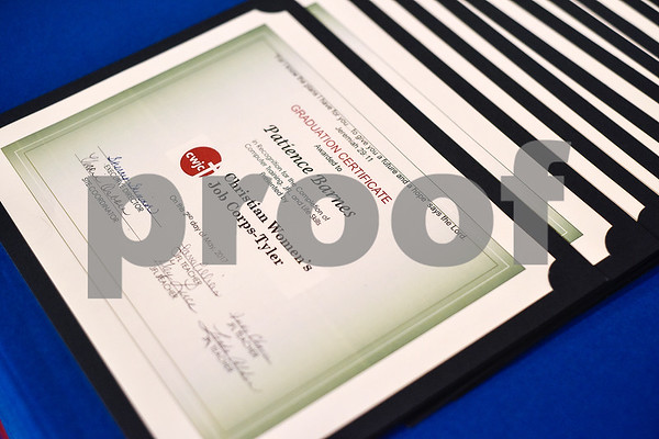 Graduation certificates photographed during a graduation ceremony for students with the Christian Women's Job Corps of Tyler at First Baptist Church in Tyler, Texas, on Tuesday, May 2, 2017.The nearly 60 graduates participated in a ten-week program with the nonprofit, whose mission is to equip women with job skills and life skills in a Christ-centered environment. (Chelsea Purgahn/Tyler Morning Telegraph)