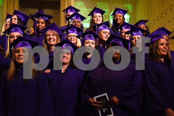 Graduates pose for a photo during a graduation ceremony for students with the Christian Women's Job Corps of Tyler at First Baptist Church in Tyler, Texas, on Tuesday, May 2, 2017.The nearly 60 graduates participated in a ten-week program with the nonprofit, whose mission is to equip women with job skills and life skills in a Christ-centered environment. (Chelsea Purgahn/Tyler Morning Telegraph)