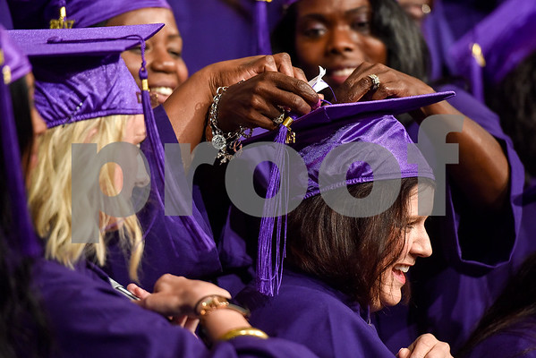 Graduates help Cindy Couch put her tassel back on her hat during a graduation ceremony for students with the Christian Women's Job Corps of Tyler at First Baptist Church in Tyler, Texas, on Tuesday, May 2, 2017.The nearly 60 graduates participated in a ten-week program with the nonprofit, whose mission is to equip women with job skills and life skills in a Christ-centered environment. (Chelsea Purgahn/Tyler Morning Telegraph)