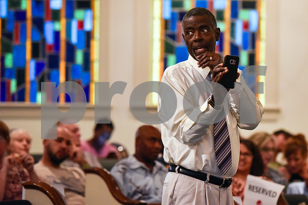 Paul Phillips glances over his shoulder while taking a video during a graduation ceremony for students with the Christian Women's Job Corps of Tyler at First Baptist Church in Tyler, Texas, on Tuesday, May 2, 2017.The nearly 60 graduates participated in a ten-week program with the nonprofit, whose mission is to equip women with job skills and life skills in a Christ-centered environment. (Chelsea Purgahn/Tyler Morning Telegraph)