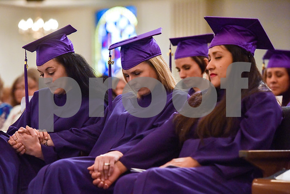 Graduates pray during a graduation ceremony for students with the Christian Women's Job Corps of Tyler at First Baptist Church in Tyler, Texas, on Tuesday, May 2, 2017.The nearly 60 graduates participated in a ten-week program with the nonprofit, whose mission is to equip women with job skills and life skills in a Christ-centered environment. (Chelsea Purgahn/Tyler Morning Telegraph)