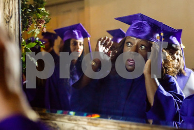 Sharon Calico fixes her hat in the mirror during a graduation ceremony for students with the Christian Women's Job Corps of Tyler at First Baptist Church in Tyler, Texas, on Tuesday, May 2, 2017.The nearly 60 graduates participated in a ten-week program with the nonprofit, whose mission is to equip women with job skills and life skills in a Christ-centered environment. (Chelsea Purgahn/Tyler Morning Telegraph)