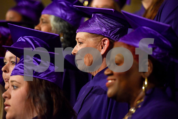 Michelle Cole poses for a photo with other graduates during a graduation ceremony for students with the Christian Women's Job Corps of Tyler at First Baptist Church in Tyler, Texas, on Tuesday, May 2, 2017.The nearly 60 graduates participated in a ten-week program with the nonprofit, whose mission is to equip women with job skills and life skills in a Christ-centered environment. (Chelsea Purgahn/Tyler Morning Telegraph)