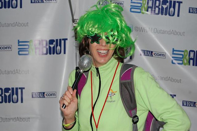 The WRAL Out & About booth had fun with props at Band Together and Jenny's photo was posted on the WRAL website!