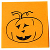 Jack-o-lantern smiling on a sticky note.