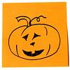 Jack-o-lantern smiling on a sticky note.