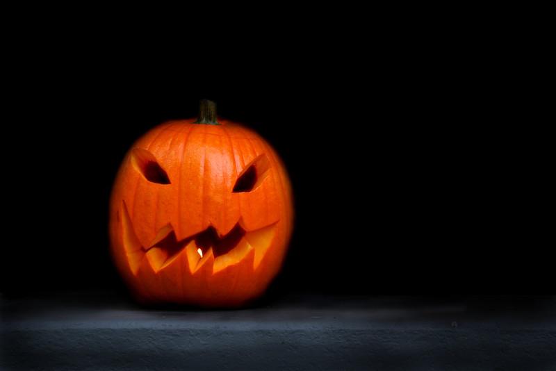 Creepy jack-o-lantern against a severe black background.