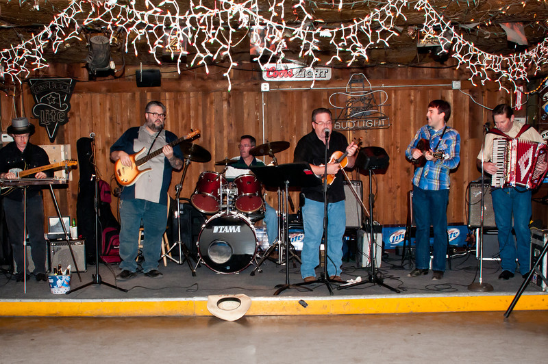 Brian Marshall and friends entertain at Wisnoski party.