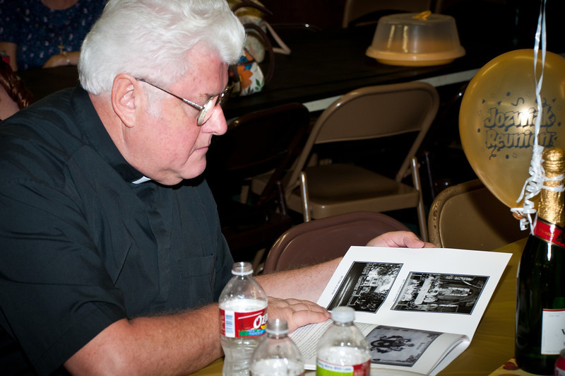 St. Stanislaus Pastor Fr. Józef Musiol Studying The Jozwiak Family History Book
