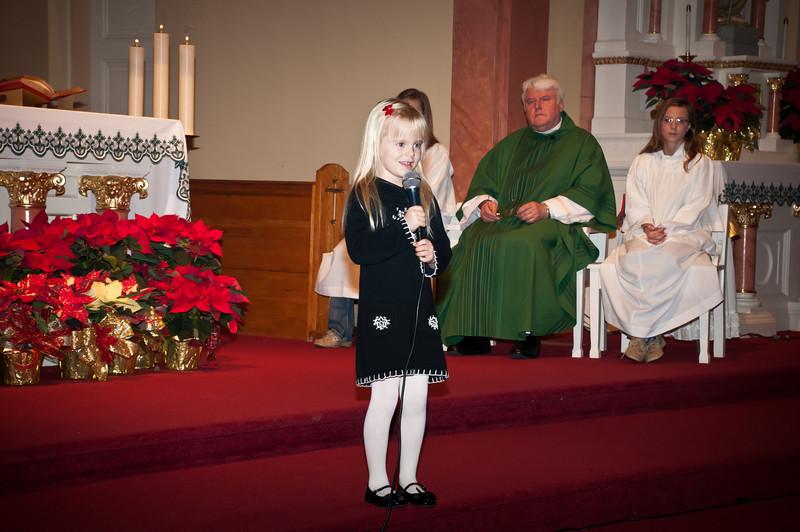 Young Sarah Winiarska sings Przybiezeli do Bethlehem during offertory at Mass