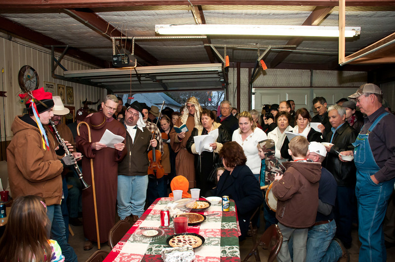 Musicians and carolers singing koledy.