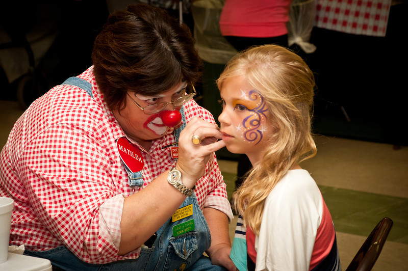 Matilda the Clown painting a child's face