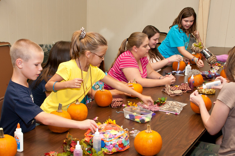 Pumpkin decorating was a popular activity for the kids
