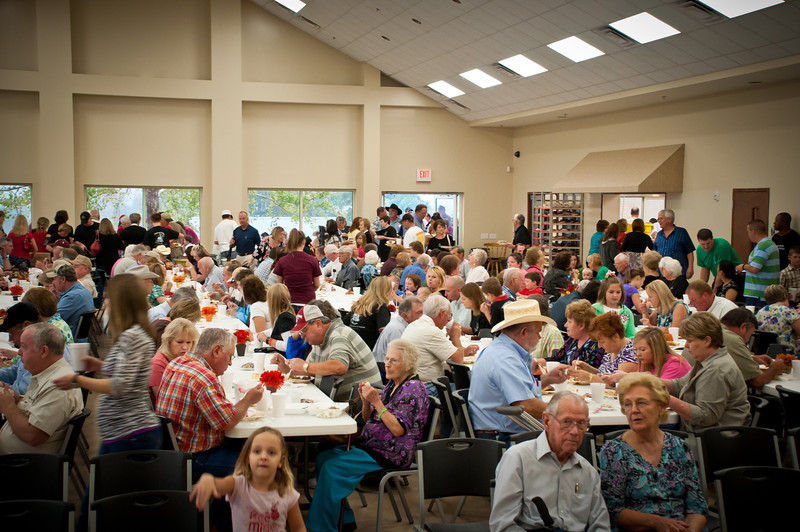 Hungry crowd enjoying the delicious meal in the large parish hall