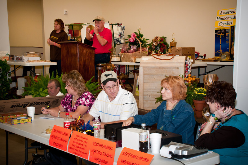Tommy Szymczak and his crew selling auction items