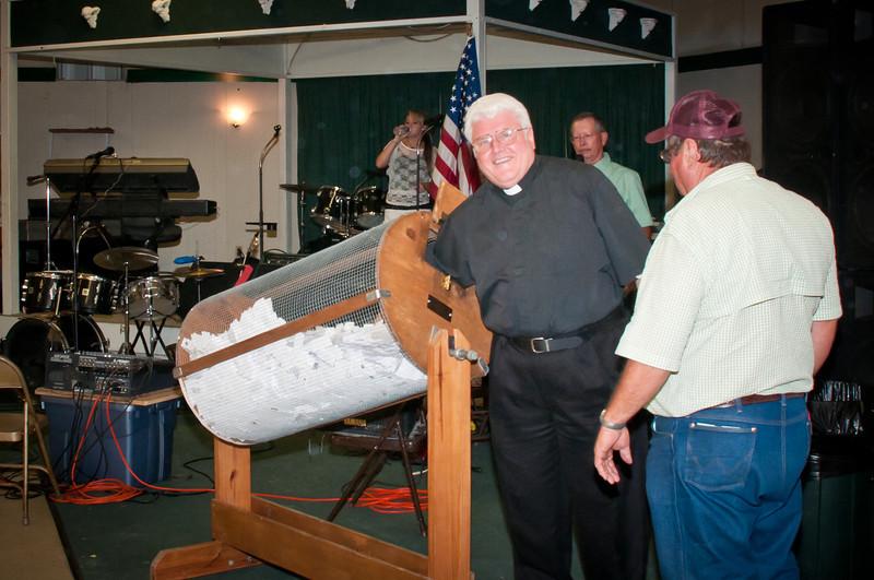St. Stanislaus Pastor Fr. Jozef picks the winning raffle ticket