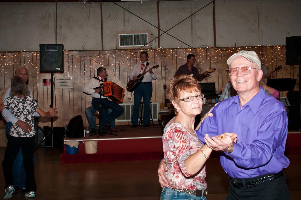 Dancing to the traditional Polish music.