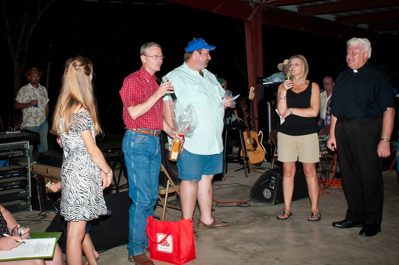 Dr. Jim Mazurkiewicz presents a bottle of Polish vodka to the top ticket seller