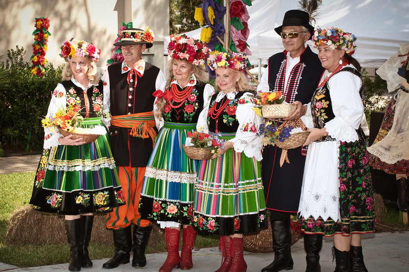"Kathy Mazurkiewicz, Dr. Jim Mazurkiewicz, Basia Ostrowski, Marianna Lech, Dr. Zbigniew  Wojciechowski and Grazyna Wojciechowski in Polish Folk costumes representing the Łowicz and Krakow Regions of Poland at the 2012 ""Dozynki"" festival in Houston."