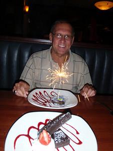 Dennis with birthday sparkle dessert at Michael Dean's