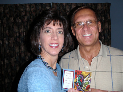 Dennis and Jenny with Michael Dean's gift card before dinner (self-portrait!)