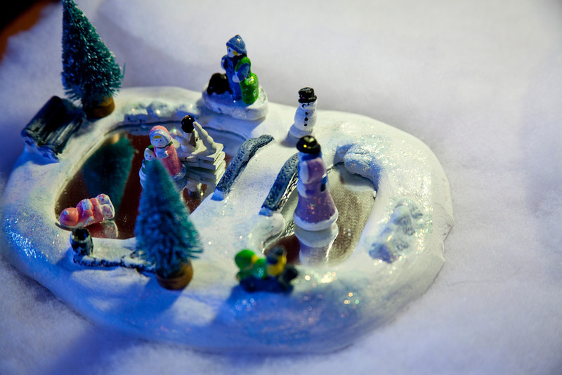 Little ice-skaters and sledders play on this vintage Christmas decoration.