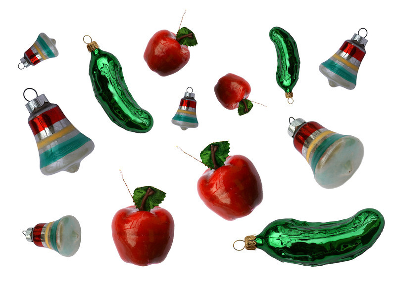 A background of an assortment of glass Christmas ornaments.