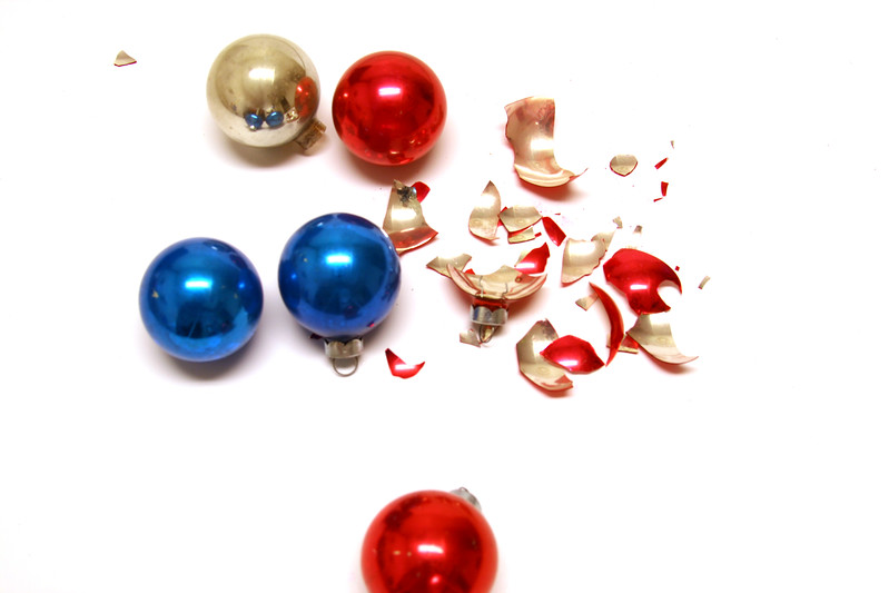Wreck the halls? Glass Christmas bulbs, but one is broken.