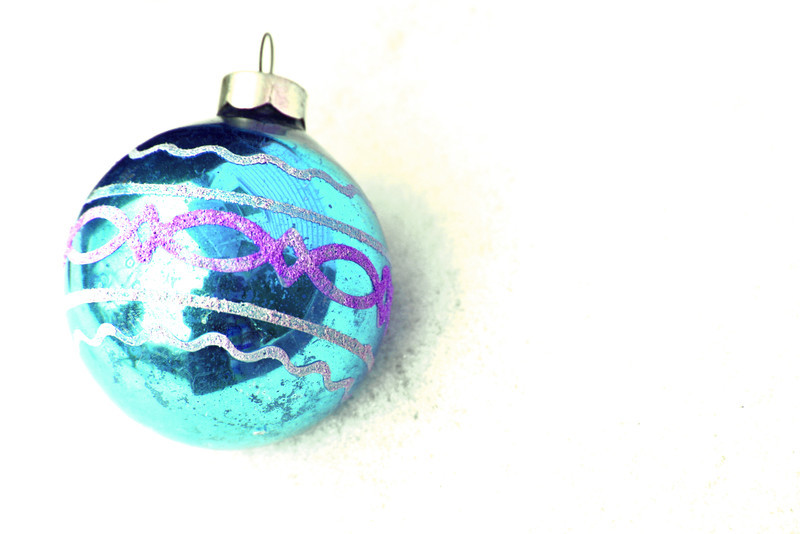Retro Christmas decoration. A blue glass bulb in the snow.