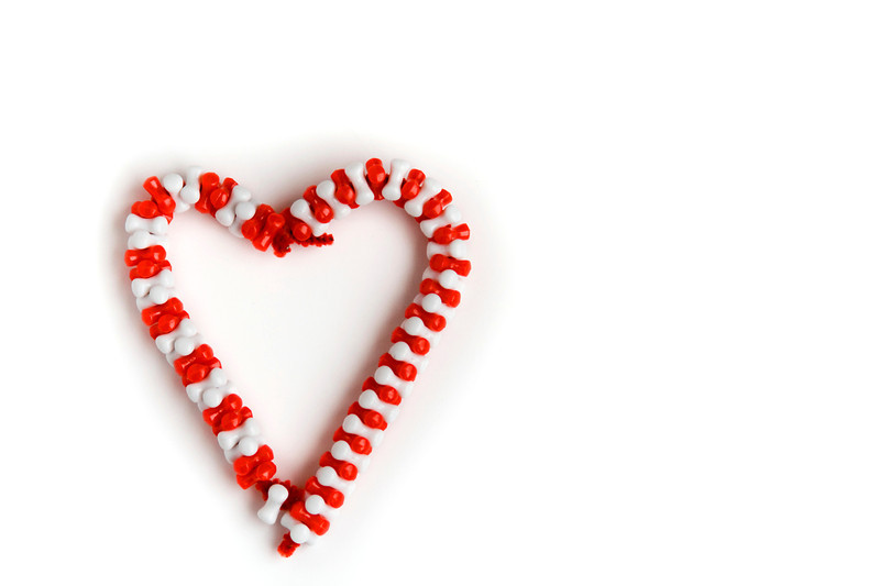 Two homemade bead candy canes make a loving display of Christmas feeling.