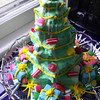 A cake for Christmas. Yes, that's cake, stacked high and decorated like a tree.