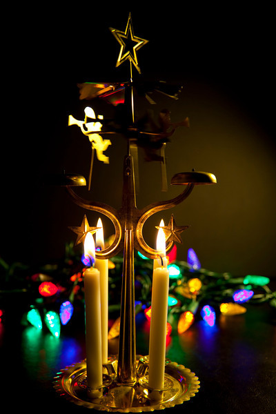 Classic Swedish angel chime with a backdrop of Christmas lights.