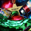 Find the true meaning of Christmas in this background of ornaments with HOPE in the center.