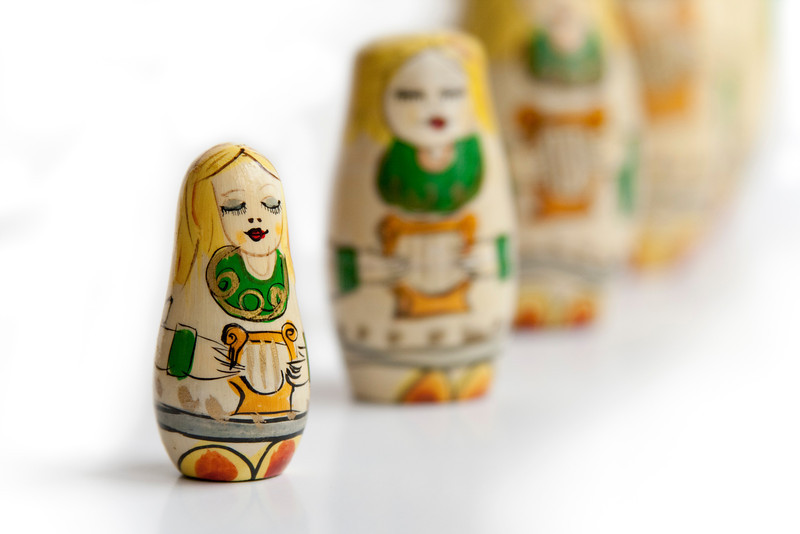 Nesting angel dolls in a row. Playing their sweet little harps.