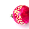 Vintage pink Christmas ornament on a white background.