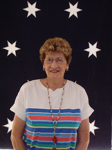 Mom in front of colonial flag