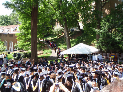 Faculty recessional back up the hill behind the Science Building